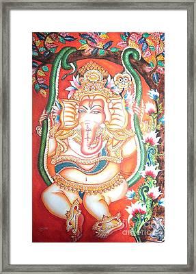 Baby Ganesha Swinging On A Snake Framed Print by Jayashree