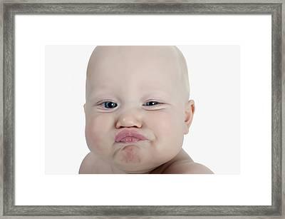 Baby Making A Funny Face Framed Print by Stuart Corlett