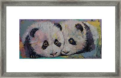 Baby Pandas Framed Print by Michael Creese