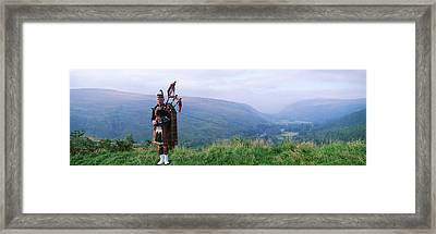 Bagpiper At Loch Broom In Scottish Framed Print by Panoramic Images