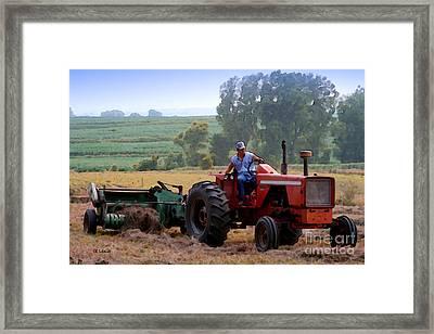 Baling Hay Framed Print by E B Schmidt
