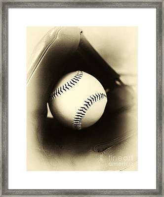 Ball In Glove Framed Print by John Rizzuto