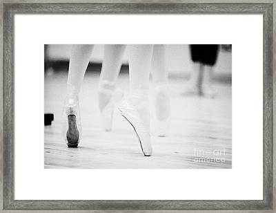 Ballet Students Demonstrating En Pointe Classical Technique At A Ballet School In The Uk Framed Print by Joe Fox