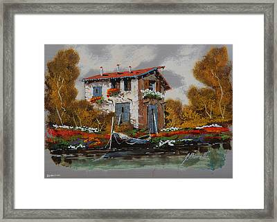 Barca Al Molo Framed Print by Guido Borelli