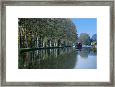 Barge On Burgandy Canal Framed Print by Carl Purcell