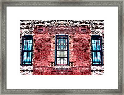 Barred Windows On Brick Framed Print by Dan Sproul