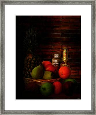 Basket Of Colors Framed Print by Lourry Legarde