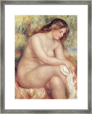 Bather Drying Herself Framed Print by Pierre Auguste Renoir