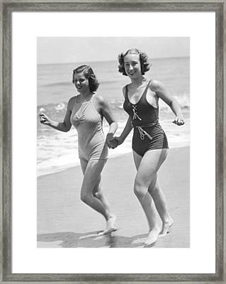 Beach Jogging Pals Framed Print by Underwood Archives