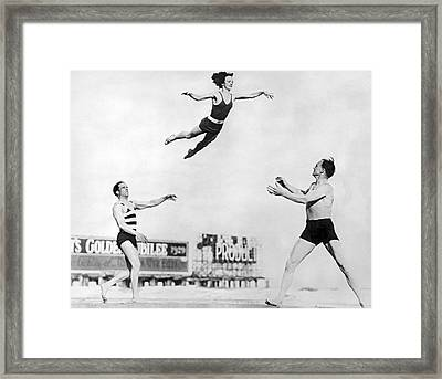 Beach Performers Toss Woman Framed Print by Underwood Archives