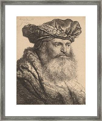 Bearded Man In A Velvet Cap With A Jewel Clasp Framed Print by Rembrandt
