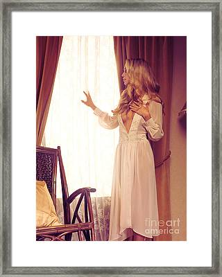 Beautiful Blond Woman In Night Gown Looking Out Of The Window Framed Print by Oleksiy Maksymenko