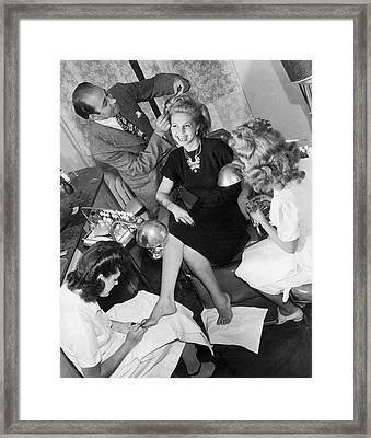 Beauty Salon Glamorizing Framed Print by Underwood Archives