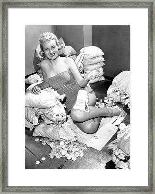 Beauty Surrounded By Money Framed Print by Retro Images Archive