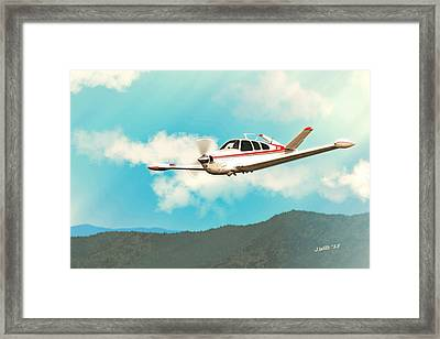 Beechcraft Bonanza V Tail Red Framed Print by John Wills