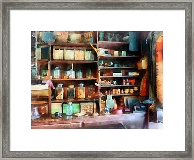 Behind The Counter At The General Store Framed Print by Susan Savad