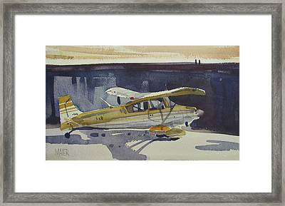 Behind The Hanger Framed Print by Donald Maier