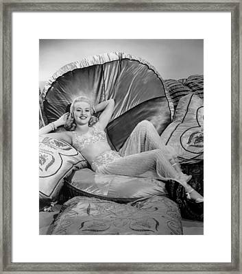 Betty Grable Reclining Framed Print by Studio Release