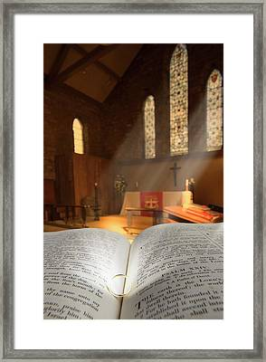 Bible With A Ring In Church Sanctuary Framed Print by John Short