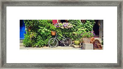 Bicycle In Front Of Wall Covered With Framed Print by Panoramic Images