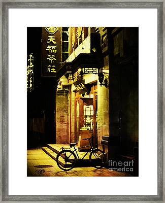 Bicycle On The Streets Of Beijing At Night Framed Print by Jani Bryson