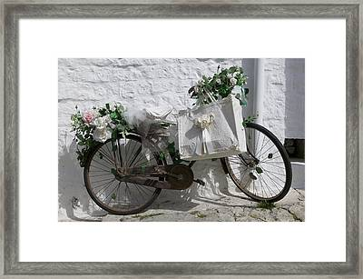 Bicycle Parked Against A Wall, Trulli Framed Print by Panoramic Images