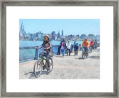 Hoboken Nj - Bicycling Along Pier A Framed Print by Susan Savad
