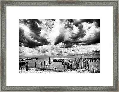 Big Clouds Little Dock Framed Print by John Rizzuto