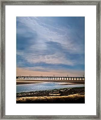 Big Skies Over The Pier Framed Print by Eva Kondzialkiewicz
