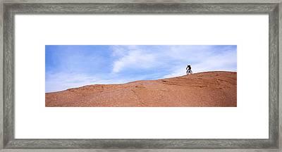 Biker On Slickrock Trail, Moab, Grand Framed Print by Panoramic Images