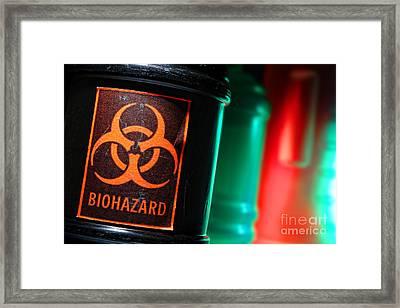 Biohazard Framed Print by Olivier Le Queinec