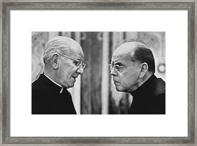 Bishops Talk Framed Print by Underwood Archives