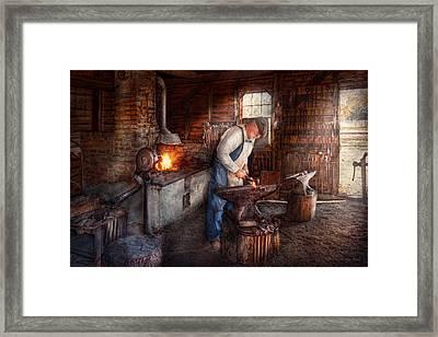 Blacksmith - The Smith Framed Print by Mike Savad