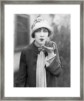 Blowing A Kiss Framed Print by Underwood Archives