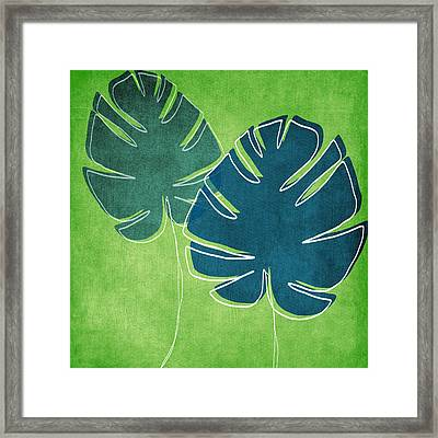 Blue And Green Palm Leaves Framed Print by Linda Woods