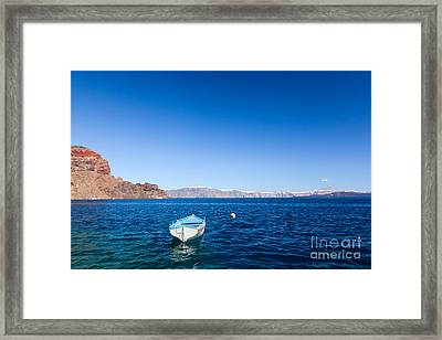 Blue And White Boat On The Aegean Sea Framed Print by Michal Bednarek