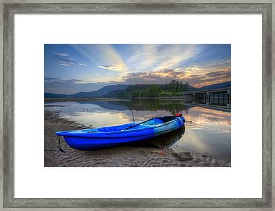 Blue Canoe At Sunset Framed Print by Debra and Dave Vanderlaan