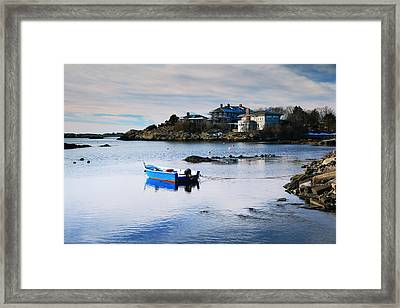 Blue Skiff On A Winter Cove Framed Print by Roupen  Baker