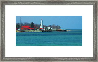Blue Water Lighthouse Framed Print by Peg Holmes