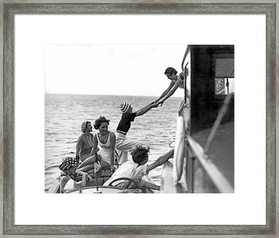 Boarding A Fishing Cruiser Framed Print by Underwood Archives