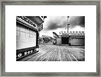 Boardwalk Angles Framed Print by John Rizzuto