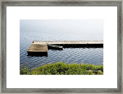 Boat Moored To Old Cracked Wood Bridge  Framed Print by Arletta Cwalina