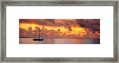 Boat At Sunset Framed Print by Panoramic Images