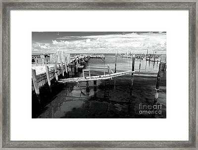 Boat Dock Framed Print by John Rizzuto