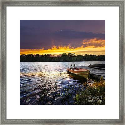 Boat On Lake At Sunset Framed Print by Elena Elisseeva