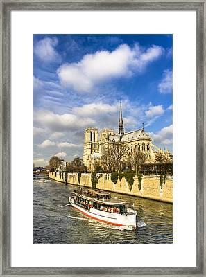 Boat Passing Notre Dame De Paris  Framed Print by Mark E Tisdale