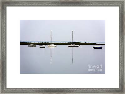 Boat Reflections Framed Print by John Rizzuto
