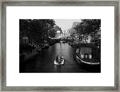 Boating On The Canals Of Amsterdam Framed Print by Aidan Moran