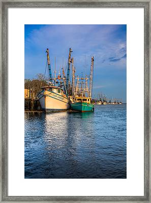 Boats In Blue Framed Print by Debra and Dave Vanderlaan