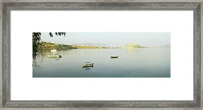 Boats In The Sea With A City Framed Print by Panoramic Images